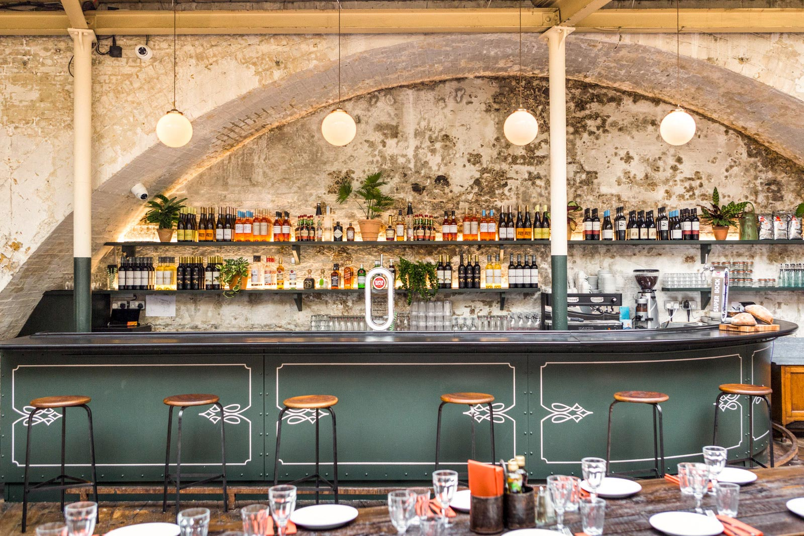 Globe Pendant Lights in this Rustic Portuguese Restaurant in London