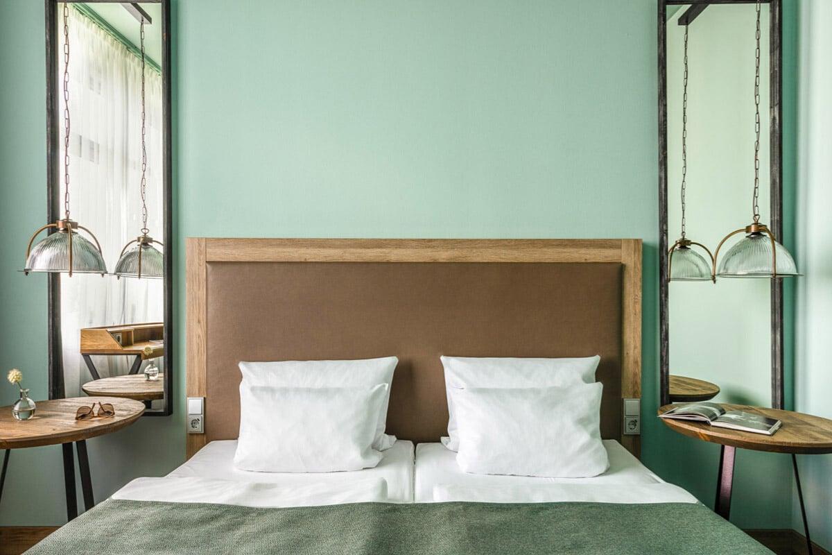 Holophane Pendants Transform the Bedroom of This Berlin Hotel