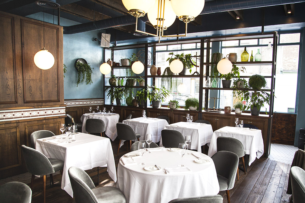 An ensemble of opal glass shades at the finely tuned Noizé restaurant, London