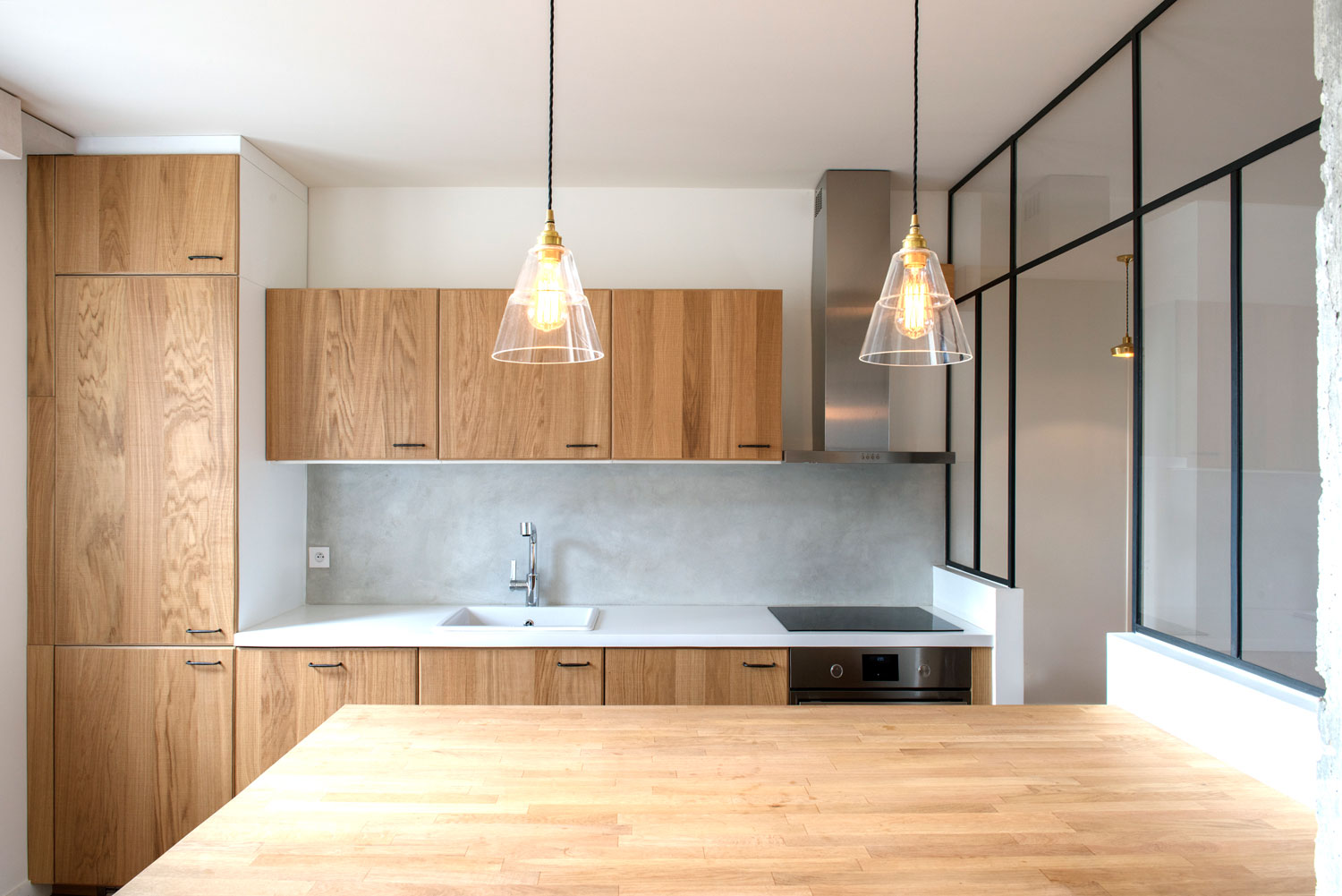 This charismatic kitchen space features our Lyx clear glass pendant lights
