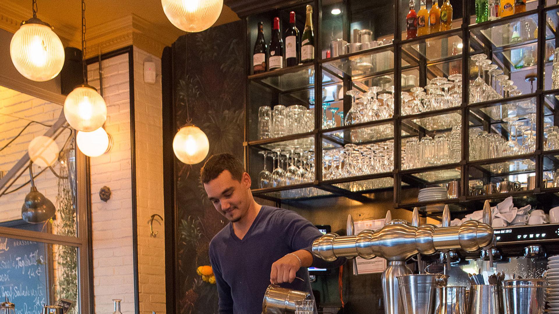 Holophane glass shades help create warm tones in Manfred café, Paris
