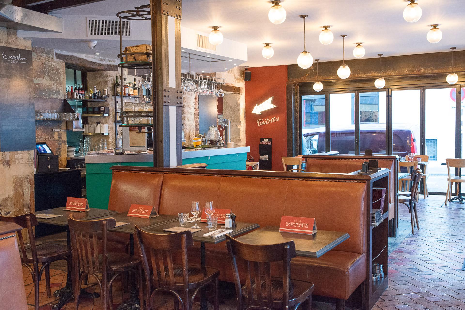 Enjoy the ultimate Parisian café experience under our ceiling lights at Café Petite