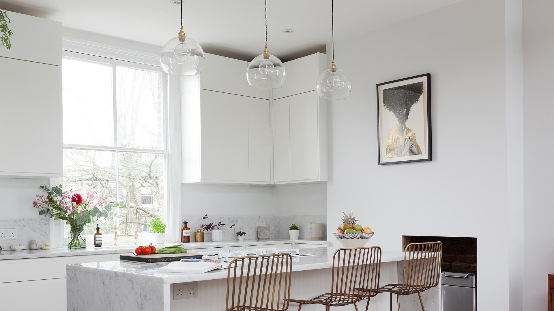 Our Eden globe pendants look perfect above this kitchen island