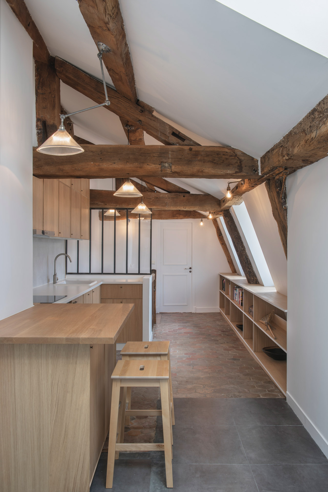Prismatic glass shades help bring this rustic Parisian apartment to life
