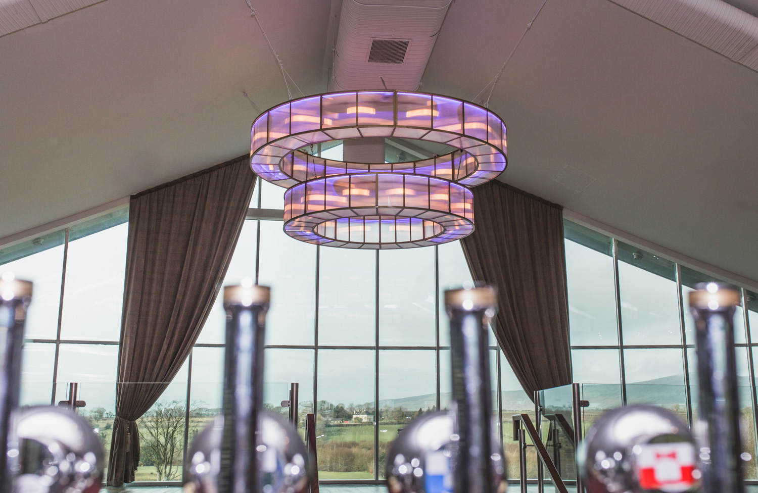 We manufactured this 3-metre double ring chandelier for the Foyle Golf Centre