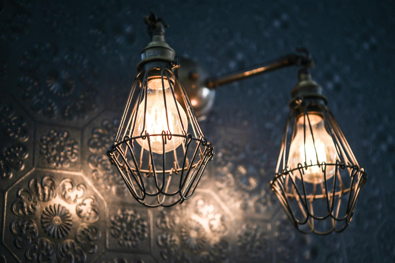 Industrial lighting helps enliven the traditional charm at O'Reilly's Irish pub, Brussels
