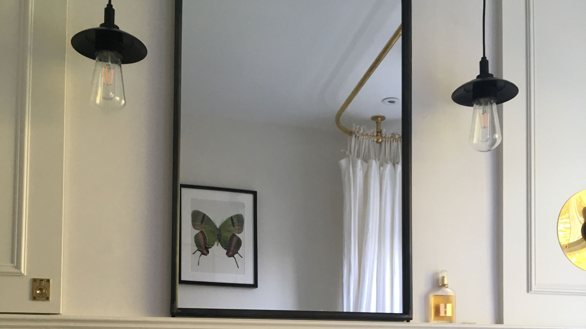 Our Ren pendants capture the vintage flair of this London bathroom