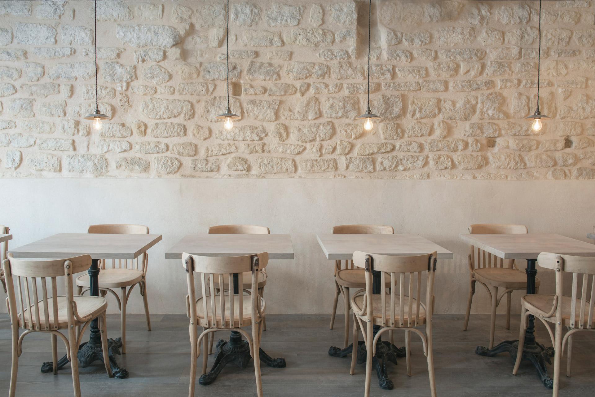 Our Reznor pendants illuminate this rustic Parisian restaurant